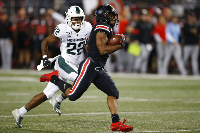 Ohio State running back J.K. Dobbins, right, heads for a touchdown while trailed by Michigan State defensive back Josiah Scott during the first half of an NCAA college football game Saturday, Oct. 5, 2019, in Columbus, Ohio. (AP Photo/Jay LaPrete)
