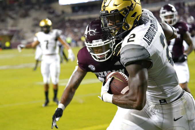 Vanderbilt's Amir Abdur-Rahman (2) catches a pass for a touchdown as Texas A&M's Jaylon Jones defends during the second half of an NCAA college football game Saturday, Sept. 26, 2020, in College Station, Texas. Texas A&M won 17-12. (AP Photo/David J. Phillip)