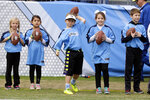 In this Dec. 6, 2015, photo, kids get ready to take part in a halftime activity for the Play 60 exercise initiative at an NFL football game between the Tennessee Titans and the Jacksonville Jaguars in Nashville, Tenn. USA Football has unveiled a council that will oversee the implementation of its Football Development Model for the sport to help parents, coaches and program leaders provide what players need to develop and grow as athletes and people through football participation. (AP Photo/James Kenney)