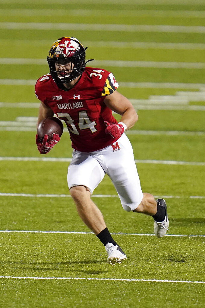 Maryland running back Jake Funk runs with the ball against Minnesota during the second half of an NCAA college football game, Friday, Oct. 30, 2020, in College Park, Md. (AP Photo/Julio Cortez)
