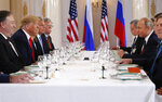 U.S. President Donald Trump, second from left, and Russian President Vladimir Putin, second from right, wait for the beginning of a working lunch at the Presidential Palace in Helsinki, Finland, Monday, July 16, 2018. (AP Photo/Pablo Martinez Monsivais)