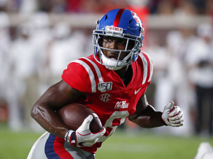 Mississippi wide receiver Elijah Moore looks for Arkansas defenders on his way to a touchdown after a reception during the second half of an NCAA college football game Saturday, Sept. 7, 2019, in Oxford, Miss. Mississippi won 31-17. (AP Photo/Rogelio V. Solis)