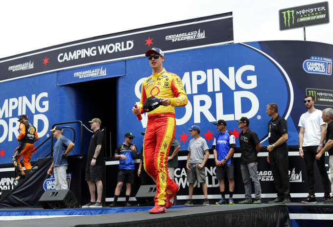 Joey Logano greets to the crowd during drivers introduction before the NASCAR Cup Series auto race at Chicagoland Speedway in Joliet, Ill., Sunday, June 30, 2019. (AP Photo/Nam Y. Huh)