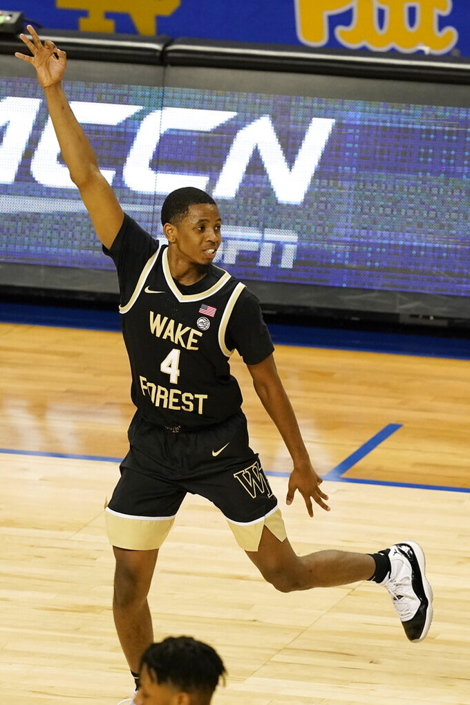 Wake Forest guard Daivien Williamson (4) celebrates a three pointer during the first half of an NCAA college basketball game against Notre Dame in the first round of the Atlantic Coast Conference tournament in Greensboro, N.C., Tuesday, March 9, 2021. (AP Photo/Gerry Broome)