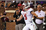 North Carolina State wide receiver Thayer Thomas (5) tosses the football to an official after catching a touchdown pass against Mississippi State during the second half of an NCAA college football game in Starkville, Miss., Saturday, Sept. 11, 2021. (AP Photo/Rogelio V. Solis)