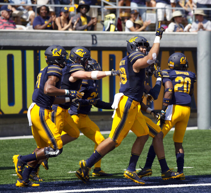 California players celebrate after Cameron Goode ran a North Carolina interception back for a touchdown during the first half of an NCAA college football game, Saturday, Sept. 1, 2018, in Berkeley, Calif. (AP Photo/D. Ross Cameron)