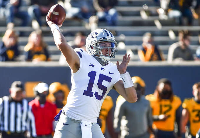 Kansas State quarterback Will Howard (15) passes against West Virginia during an NCAA college football game, Saturday, Oct. 31, 2020, in Morgantown, W.Va. (William Wotring/The Dominion-Post via AP)