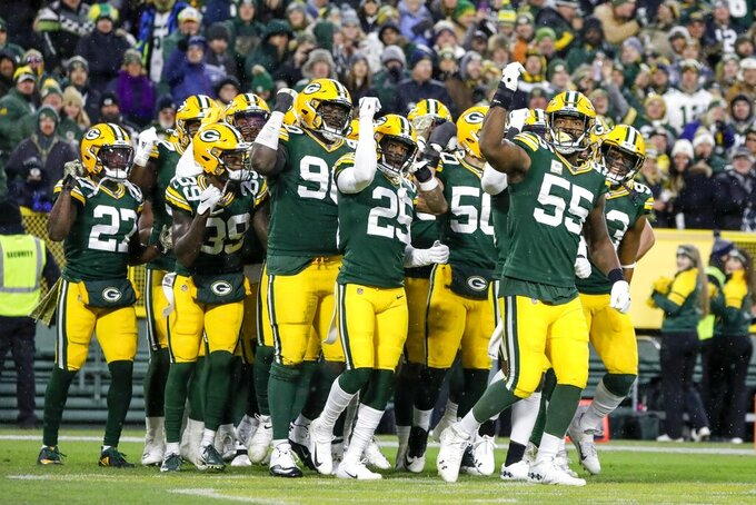 The Green Bay Packers defense reacts after Montravius Adams recovered a fumble during the first half of an NFL football game against the Carolina Panthers Sunday, Nov. 10, 2019, in Green Bay, Wis. (AP Photo/Jeffrey Phelps)