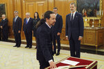 Podemos (United We Can) leader Pablo Iglesias takes his oath of office during the swearing in ceremony at the Zarzuela Palace just outside of Madrid, Spain, Monday Jan. 13, 2020. Iglesias will be the deputy prime minister in charge of social rights and sustainable development in. in Spain's center to far left-wing coalition administration. (Chema Moya/ Pool Photo via AP)