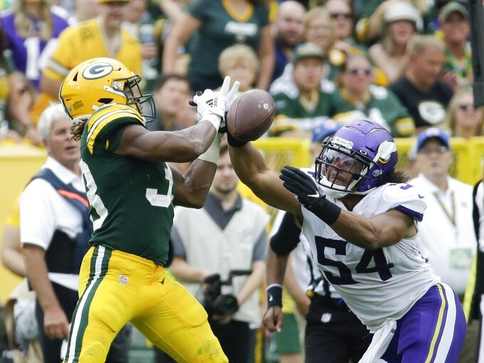 Minnesota Vikings' Eric Kendricks breaks up a pass intended for Green Bay Packers' Aaron Jones during the second half of an NFL football game Sunday, Sept. 15, 2019, in Green Bay, Wis. The Packers won 21-16. (AP Photo/Mike Roemer)