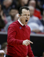 New Mexico coach Paul Weir yells during the first half of the team's NCAA college basketball game against Utah State in the Mountain West Conference men's tournament Thursday, March 14, 2019, in Las Vegas. (AP Photo/Isaac Brekken)