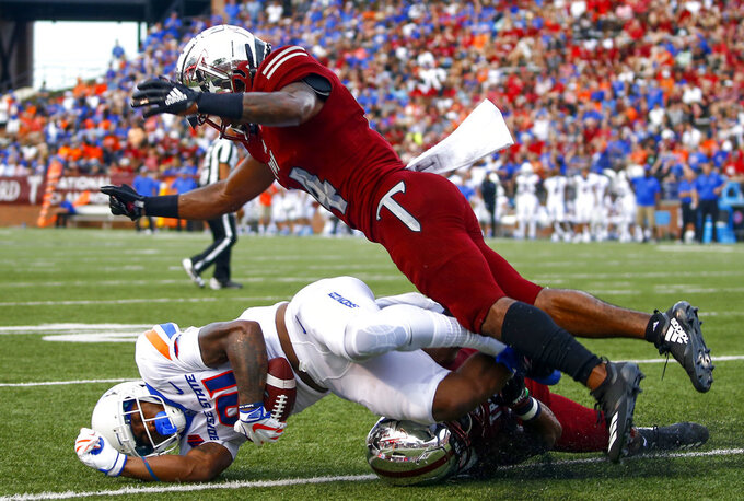 Boise State wide receiver Akilian Butler (81) catches a pass for a touchdown against Troy cornerback Terence Dunlap (14) and safety Cedarius Rookard (5) during the first half of an NCAA college football game, Saturday, Sept. 1, 2018, in Troy, Ala. (AP Photo/Butch Dill)