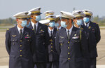 French Air Force officers wearing protective face masks as precaution against the conoravirus await French Defense Minister Florence Parly during a ceremony at the airbase of Villacoublay, west of Paris, Friday, Sept. 11, 2020. France has seen a sharp uptick in new Covid cases in recent weeks. (AP Photo/Michel Euler)