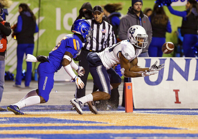 Utah State wide receiver Jalen Greene (21) catches a pass for a touchdown in front of Boise State cornerback Jalen Walker, left, during the first half of an NCAA college football game Saturday, Nov. 24, 2018, in Boise, Idaho. (AP Photo/Steve Conner)