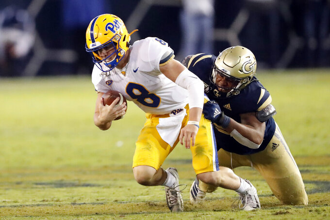 Pittsburgh quarterback Kenny Pickett (8) is sacked by Georgia Tech defensive lineman Antwan Owens (89) in the second half of an NCAA college football game Saturday, Nov. 2, 2019, in Atlanta. (AP Photo/John Bazemore)