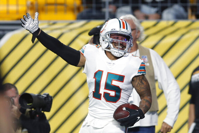 Miami Dolphins wide receiver Albert Wilson (15) celebrates his touchdown during the first half of an NFL football game against the Pittsburgh Steelers in Pittsburgh, Monday, Oct. 28, 2019. (AP Photo/Keith Srakocic)