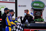 NASCAR driver Justin Allgaier, left, celebrates with his team after a win after a NASCAR Xfinity Series at Atlanta Motor Speedway on Saturday, March 20, 2021, in Hampton, Ga. (AP Photo/Brynn Anderson)