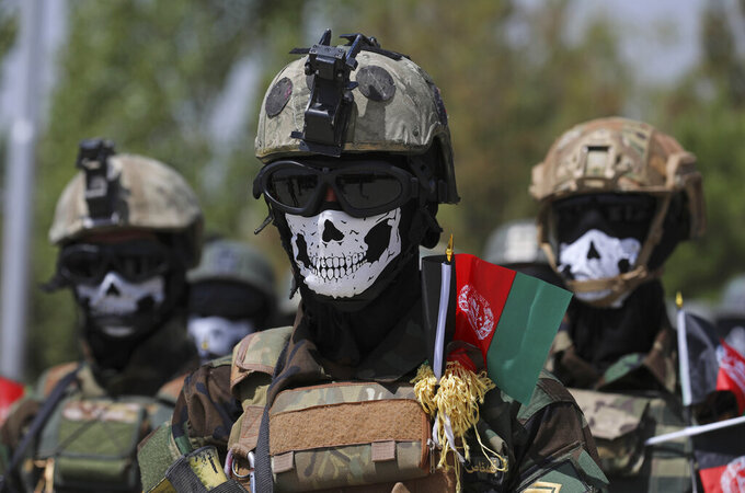 New Afghan Army Special Forces attend their graduation ceremony after a three-month training program at the Kabul Military Training Centre (KMTC) in Kabul, Afghanistan, Saturday, July 17, 2021. (AP Photo/Rahmat Gul)