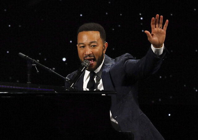 FILE - This March 5, 2020 file photo shows John Legend performing at The Alliance for Children's Rights 28th Annual Dinner in Beverly Hills, Calif. John Legend, Gabrielle Union and Ava DuVernay are some of the many black cultural leaders who have signed a letter to fight against racism, promote equal pay and ask industries to disassociate from police. The letter was released Friday, June 19, 2020 by a new organization called the Black Artists for Freedom, which describes itself as a collective of black workers in the culture industries. (Photo by Willy Sanjuan/Invision/AP, File)