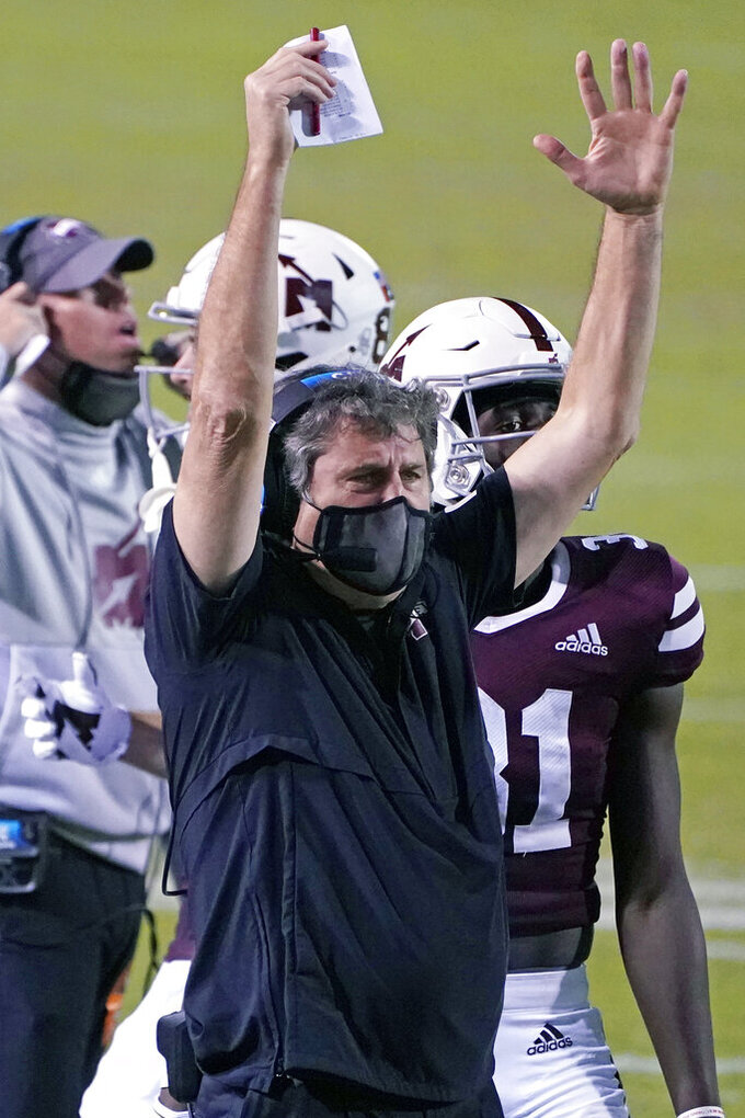 Mississippi State head coach Mike Leach signals a touchdown against Vanderbilt prematurely during the second half of an NCAA college football game in Starkville, Miss., Saturday, Nov. 7, 2020. The following play was a 1-yard touchdown dive by running back Jo'quavious Marks. (AP Photo/Rogelio V. Solis)
