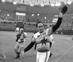FILE - In this Sept. 26, 1981, file photo, Houston Astros' Nolan Ryan waves to the crowd after pitching his fifth career no-hitter, defeating the Los Angeles Dodgers 5-0, in Houston. (AP Photo/Tim Johnson)