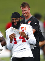 Atlanta Falcons wide receiver Justin Hardy (14) and quarterback Matt Ryan laugh during NFL football minicamp Wednesday, June 13, 2018 in Flowery Branch, Ga. (AP Photo/John Bazemore)