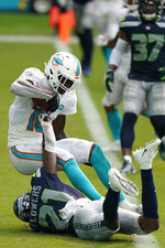 Miami Dolphins wide receiver Preston Williams (18) catches a pass in the enzone for a two point conversion as Seattle Seahawks cornerback Tre Flowers (21) defends, during the second half of an NFL football game, Sunday, Oct. 4, 2020 in Miami Gardens, Fla. (AP Photo/Wilfredo Lee)