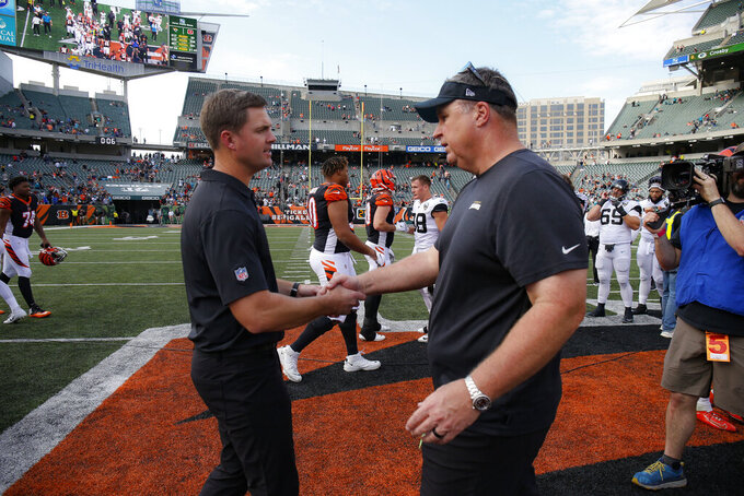 Cincinnati Bengals head coach Zac Taylor, left, meets with Jacksonville Jaguars head coach Doug Marrone, right, after an NFL football game, Sunday, Oct. 20, 2019, in Cincinnati. (AP Photo/Gary Landers)