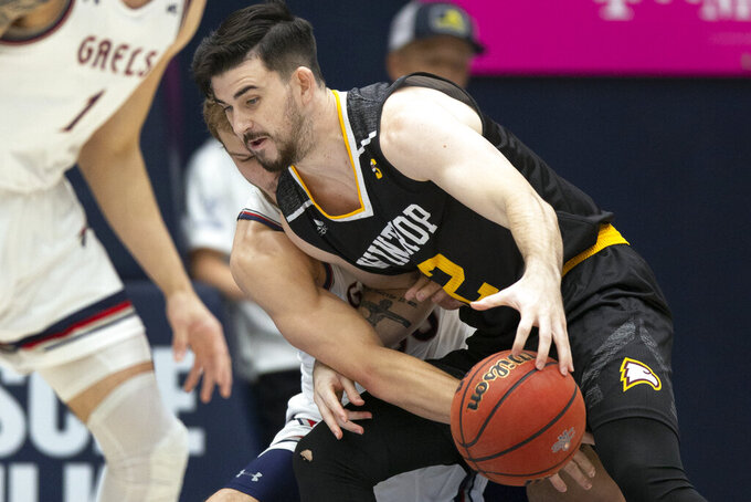 Saint Mary's guard Tanner Krebs (00) attempts to steal the ball from Winthrop guard Chandler Vaudrin (52) during the first half of an NCAA college basketball game, Monday, Nov. 11, 2019 in Moraga, Calif. (AP Photo/D. Ross Cameron)