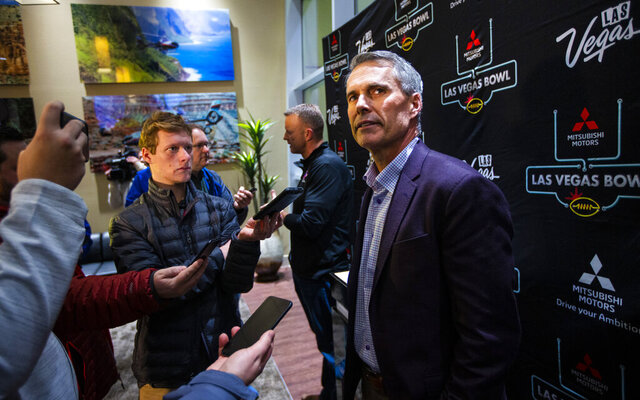 Washington head coach Chris Petersen speaks with reporters ahead of the Las Vegas Bowl NCAA college football game in Las Vegas, Tuesday, Dec. 17, 2019. (Chase Stevens/Las Vegas Review-Journal via AP)