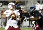 Temple quarterback Anthony Russo looks for a receiver as he is pressured by the Central Florida defense during the first half of an NCAA college football game Thursday, Nov. 1, 2018, in Orlando, Fla. (AP Photo/John Raoux)