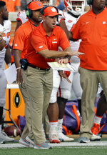 Clemson head coach Dabo Swinney signals is team during the first half of an NCAA college football game against Wake Forest in Charlotte, N.C., Saturday, Oct. 6, 2018. (AP Photo/Chuck Burton)