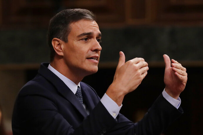 FILE - In this Tuesday, July 23, 2019 file photo, Spain's caretaker Prime Minister Pedro Sanchez speaks at the Spanish parliament in Madrid, Spain. Socialist leader Pedro Sanchez is proposing policies including pension hikes and rent controls in a bid to win parliamentary support for a new term as prime minister, but seems likely to face a new election as he rules out a coalition with an important far-left ally. The caretaker prime minister needs the parliamentary votes of the anti-austerity Podemos (We Can) to stay in office, but its leaders say Sánchez needs to include them in his new cabinet. (AP Photo/Manu Fernandez, file)