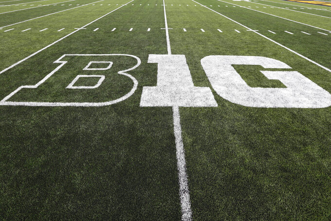 FILE - In this Aug. 31, 2019, file photo, the Big Ten logo is displayed on the field before an NCAA college football game between Iowa and Miami of Ohio in Iowa City, Iowa. Six Big Ten football games will be played at different sites than originally planned and dates for many matchups have been changed on the revised 2021 conference schedule released Friday, Feb. 5, 2021. (AP Photo/Charlie Neibergall, File)