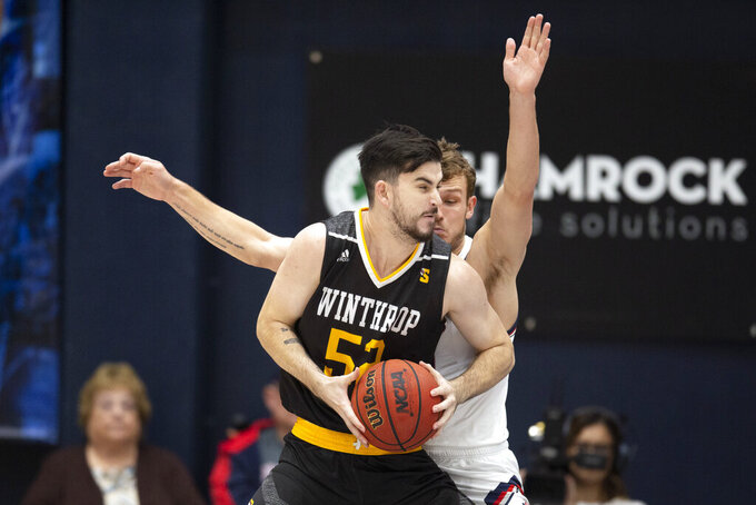 Winthrop guard Chandler Vaudrin (52) backs down Saint Mary's guard Tanner Krebs (00) during the first half of an NCAA men's college basketball game, Monday, Nov. 11, 2019 in Moraga, Calif. (AP Photo/D. Ross Cameron)