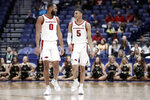 Arkansas forward Jeantal Cylla (0) and guard Jalen Harris (5) talks in the final moments of the second half of an NCAA college basketball game against Vanderbilt in the Southeastern Conference Tournament Wednesday, March 11, 2020, in Nashville, Tenn. Arkansas won 86-73. (AP Photo/Mark Humphrey)