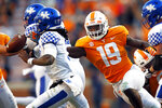 FILE - In this Nov. 10, 2018, file photo, Tennessee linebacker Darrell Taylor (19) pressures Kentucky quarterback Terry Wilson (3) in an NCAA college football game in Knoxville, Tenn. Tennessee is hoping to improve after going 5-7 in 2018 while posting a second straight last-place finish in the Southeastern Conference Eastern Division. (AP Photo/Wade Payne, File)