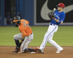 Toronto Blue Jays' Cavan Biggio, right, bobbles the baseball but gets the force-out at second base against Baltimore Orioles' Keon Broxton, left, in the third inning of a baseball game in Toronto, Saturday, July 6, 2019. (Fred Thornhill/The Canadian Press via AP)