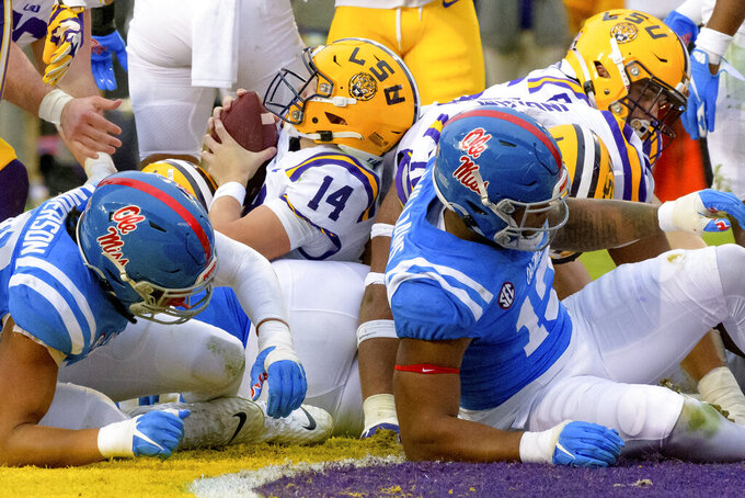 LSU quarterback Max Johnson (14) scores against Mississippi in the first half of an NCAA college football game in Baton Rouge, La., Saturday, Dec. 19, 2020. (AP Photo/Matthew Hinton)
