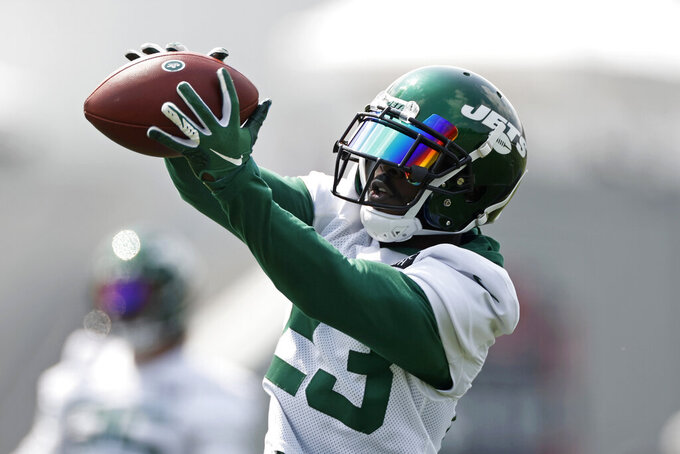 New York Jets running back Tevin Coleman makes a catch during NFL football practice Wednesday, July 28, 2021, in Florham Park, N.J. (AP Photo/Adam Hunger)