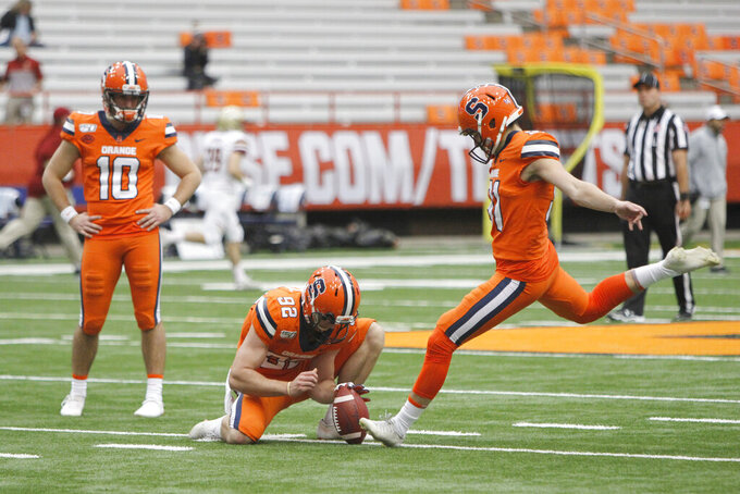 File- This Nov. 2, 2019, file photo shows Syracuse's Andre Szmyt kicking before an NCAA college football game against Boston College in Syracuse, N.Y. Syracuse has a terrific 1-2 punch in punter Sterling Hofrichter and Szmyt. Together they've helped the Orange excel on special teams for a second straight season. Hofrichter has landed 93 of his 255 career punts inside the 20-yard line with only 13 touchbacks.  (AP Photo/Nick Lisi, File)