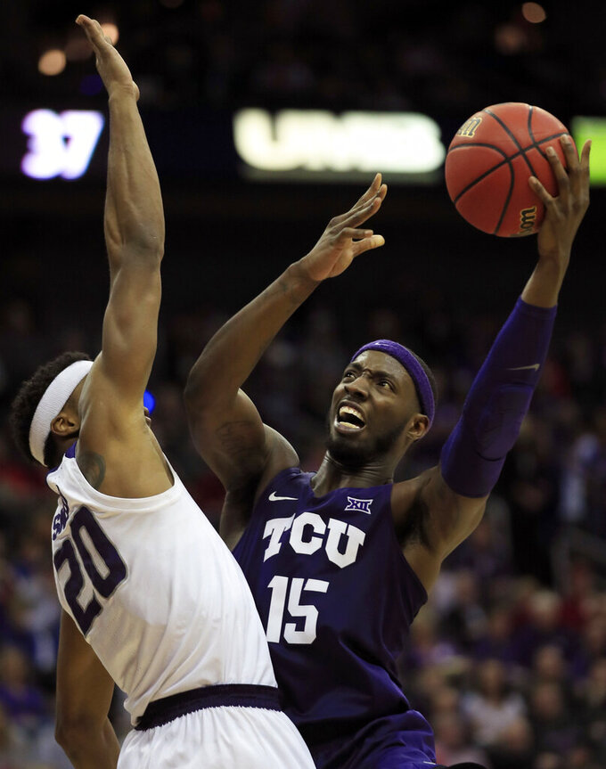 TCU forward JD Miller (15) shoots while covered by Kansas State forward Xavier Sneed (20) during the second half of an NCAA college basketball game in the quarterfinals of the Big 12 conference tournament in Kansas City, Mo., Thursday, March 14, 2019. (AP Photo/Orlin Wagner)