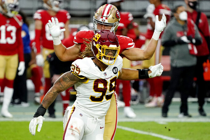 Washington Football Team defensive end Chase Young (99) battles San Francisco 49ers tight end Charlie Woerner during the first half of an NFL football game, Sunday, Dec. 13, 2020, in Glendale, Ariz. (AP Photo/Rick Scuteri)
