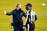 Seattle Seahawks head coach Pete Carroll, left, reacts with down judge Danny Short during the first half of an NFL football game against the Philadelphia Eagles, Monday, Nov. 30, 2020, in Philadelphia. (AP Photo/Chris Szagola)