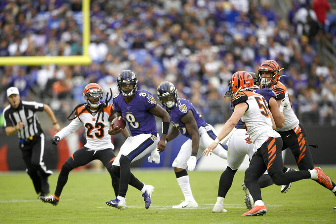 Baltimore Ravens quarterback Lamar Jackson (8) scrambles against the Cincinnati Bengals during the second half of a NFL football game Sunday, Oct. 13, 2019, in Baltimore. (AP Photo/Nick Wass)