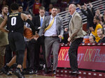 Colorado coach Tad Boyle, right, celebrates after Colorado defeated USC 69-65 in an NCAA college basketball game Saturday, Feb. 9, 2019, in Los Angeles. (AP Photo/Mark J. Terrill)