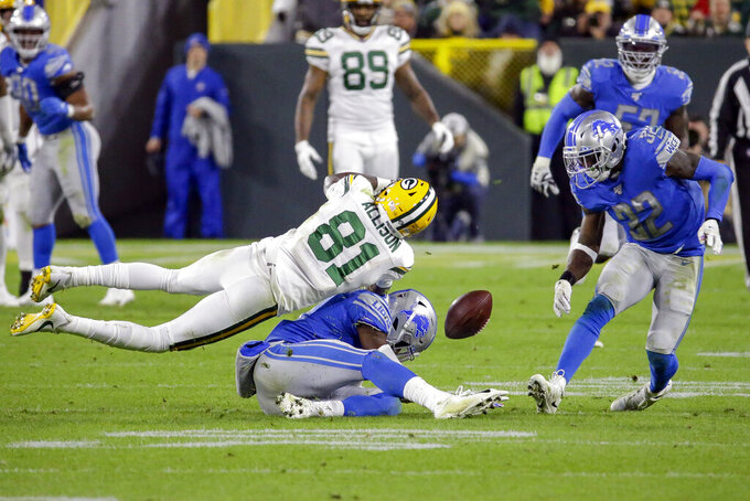 Detroit Lions defensive back Tracy Walker, bottom, and defensive back Tavon Wilson (32) break up a pass intended for Green Bay Packers wide receiver Geronimo Allison (81) during the second half of an NFL football game Monday, Oct. 14, 2019, in Green Bay, Wis. (AP Photo/Mike Roemer)