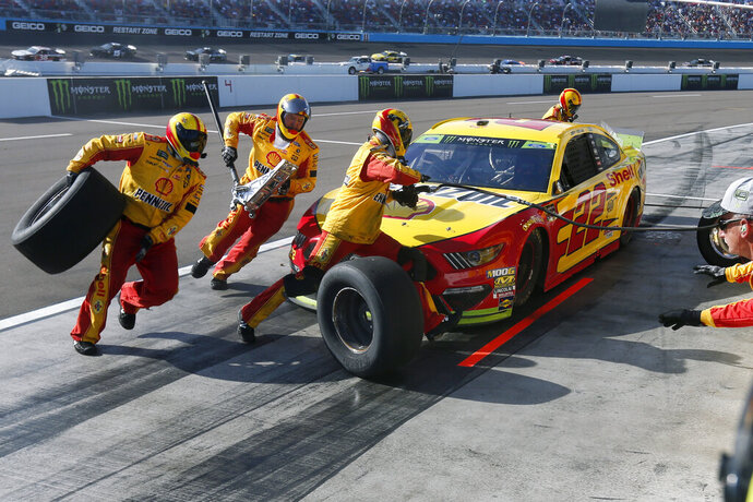 Joey Logano makes a pit stop during the NASCAR Cup Series auto race Sunday, Nov. 10, 2019, in Avondale, Ariz. (AP Photo/Ralph Freso)