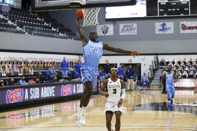 Creighton's Damien Jefferson (23) slam dunks the ball after making a steal against Providence during the first half of an NCAA college basketball game Saturday, Jan. 2, 2021, in Providence, R.I. (AP Photo/Stew Milne)
