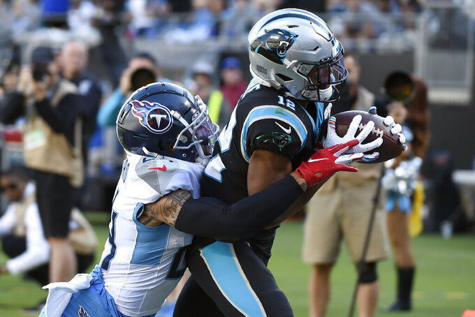 Tennessee Titans strong safety Kenny Vaccaro tackles Carolina Panthers wide receiver D.J. Moore (12) after a pass reception during the second half of an NFL football game in Charlotte, N.C., Sunday, Nov. 3, 2019. (AP Photo/Mike McCarn)